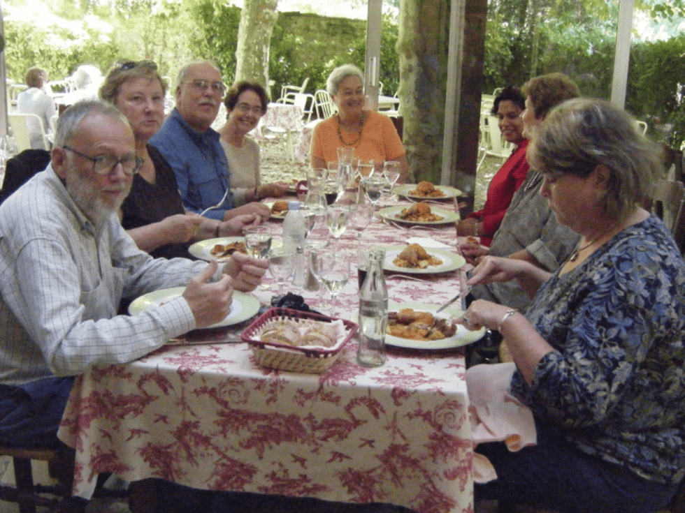 Lunch in the garden of the Hotel Cro-Magnon during a small group gourmet tour of France with Olde Ipswich Tours.