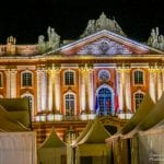 The night lights illuminating the old Capital building in Toulouse, France