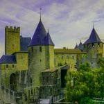 Sunrise lighting the first of 52 towers of the walled city of Carcassonne adjoining our hotel