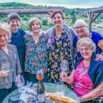 Our Olde Ipswich Tour group enjoying wine and cheese before dinner in Belesta, France